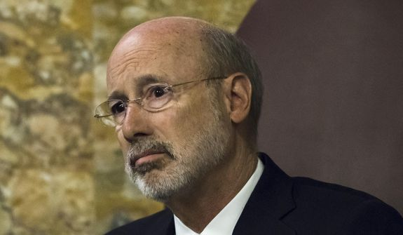 Gov. Tom Wolf listens as Pennsylvania lawmakers come together in an unusual joint session to commemorate the victims of the Pittsburgh synagogue attack that killed 11 people last year, Wednesday, April 10, 2019, at the state Capitol in Harrisburg, Pa. (AP Photo/Matt Rourke) ** FILE **