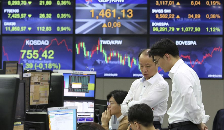 Currency traders work at the foreign exchange dealing room of the KEB Hana Bank headquarters in Seoul, South Korea, Wednesday, April 10, 2019.   Asian shares fell Wednesday following a slide on Wall Street amid growing tensions between the U.S. and the European Union and a dim forecast on global economic growth.(AP Photo/Ahn Young-joon)