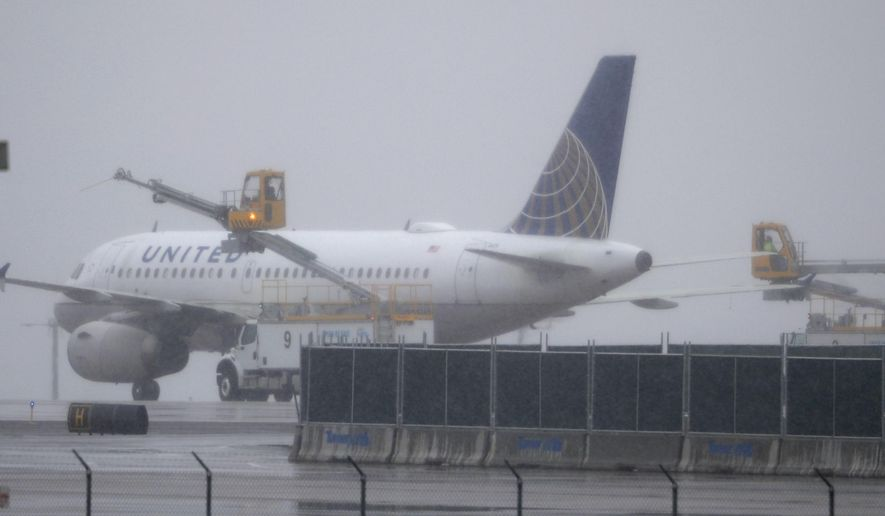 A United Airlines plane is deiced before taking off from Denver International Airport Wednesday, April 10, 2019, in Denver. Forecasters are predicting from four to 10 inches of snow for northeastern Colorado as the storm sweeps over the intermountain West Wednesday evening and into Thursday. (AP Photo/David Zalubowski)