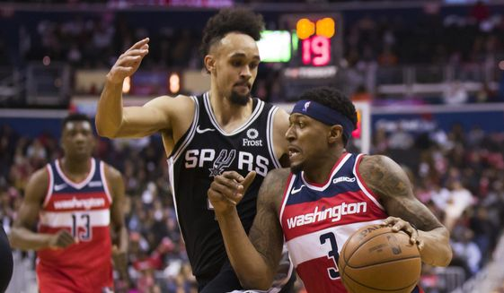 Washington Wizards guard Bradley Beal (3) works to get past San Antonio Spurs guard Derrick White during the second half of an NBA basketball game Friday, April 5, 2019, in Washington. The Spurs won 129-112. (AP Photo/Alex Brandon) **FILE**