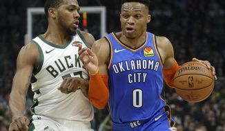 Oklahoma City Thunder's Russell Westbrook drives to the basket against Milwaukee Bucks' Sterling Brown during the first half of an NBA basketball game Wednesday, April 10, 2019, in Milwaukee. (AP Photo/Aaron Gash)