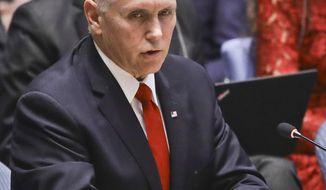 United States Vice President Mike Pence, center, address a meeting on Venezuela in the United Nations Security Council, Wednesday April 10, 2019 at U.N. headquarters. (AP Photo/Bebeto Matthews)