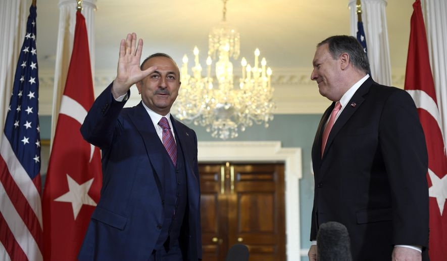 Secretary of State Mike Pompeo, right, meets with Turkish Foreign Minister Mevlut Cavusoglu on Wednesday, April 3, 2019, at the Department of State in Washington. (AP Photo/Sait Serkan Gurbuz)