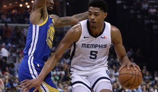 Memphis Grizzlies forward Bruno Caboclo (5) is defended by Golden State Warriors forward Alfonzo McKinnie (28) during the second half of an NBA basketball game Wednesday, April 10, 2019, in Memphis, Tenn. (AP Photo/Brandon Dill)