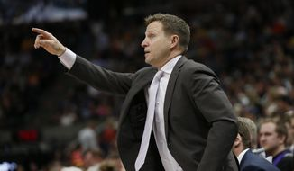 Washington Wizards head coach Scott Brooks directs his team during the first half of an NBA basketball game against the Utah Jazz, Friday, March 29, 2019, in Salt Lake City. (AP Photo/Rick Bowmer) **FILE**