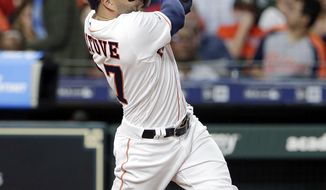Houston Astros second baseman Jose Altuve (27) watches his second home run during the fifth inning of a baseball game against the New York Yankees Wednesday, April 10, 2019, in Houston. (AP Photo/Michael Wyke)