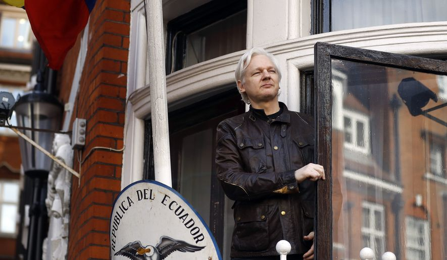 In this Friday, May 19, 2017, file photo, Julian Assange greets supporters outside the Ecuadorian Embassy in London.  London police say they've arrested WikiLeaks founder Julian Assange at the Ecuadorian Embassy, it was reported on Thursday, April 11, 2019. (AP Photo/Frank Augstein, File)