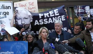 Kristinn Hrafnsson, editor of WikiLeaks, center right, and barrister Jennifer Robinson speak to the media outside Westminster magistrates court where WikiLeaks founder Julian Assange was appearing in London, Thursday, April 11, 2019. WikiLeaks founder Julian Assange was forcibly bundled out of the Ecuadorian Embassy in London and into a waiting British police van on Thursday, setting up a potential court battle over attempts to extradite him to the U.S. to face charges related to the publication of tens of thousands of secret government documents. (AP Photo/Alastair Grant)