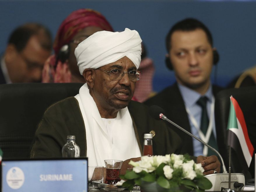 """In this May 18, 2018, file photo, Sudan's President Omar al-Bashir speaks during the extraordinary summit of the Organization of Islamic Cooperation (OIC), in Istanbul, Turkey.  Sudan's armed forces were to deliver an """"important statement"""" and asked the nation to """"wait for it"""" on Thursday, April 11, 2019, state TV reported, as two senior officials said the military had forced longtime President Omar al-Bashir to step down.(Presidential Press Service/Pool via AP, File) **FILE**"""