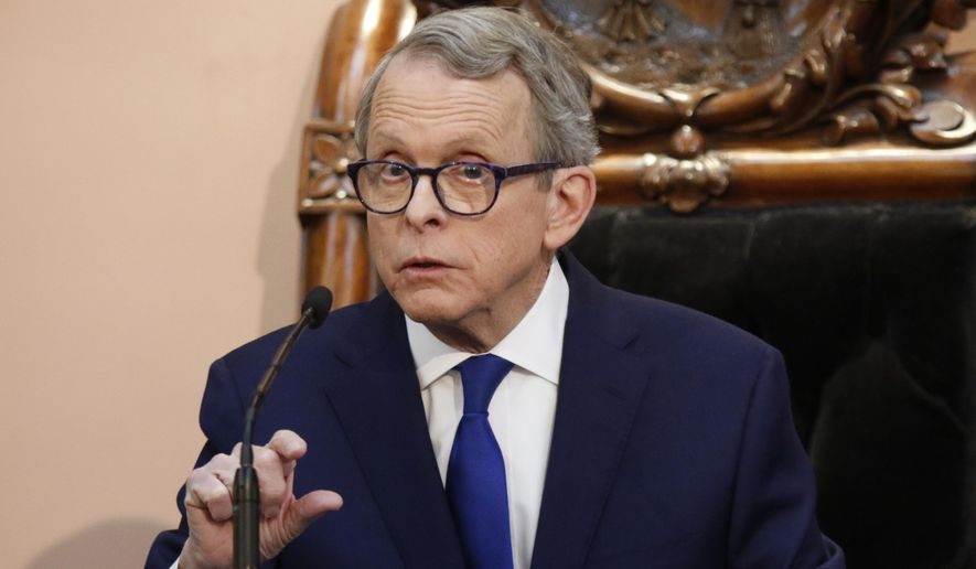 In this March 5, 2019, file photo, Ohio Gov. Mike DeWine speaks during the Ohio State of the State address at the Ohio Statehouse in Columbus. DeWine says he will sign a bill imposing one of the nation's toughest abortion restrictions, following through on his pledge to sign the heartbeat bill Thursday, April 11, 2019. The bill cleared the state Legislature on Wednesday. (AP Photo/Paul Vernon, File)