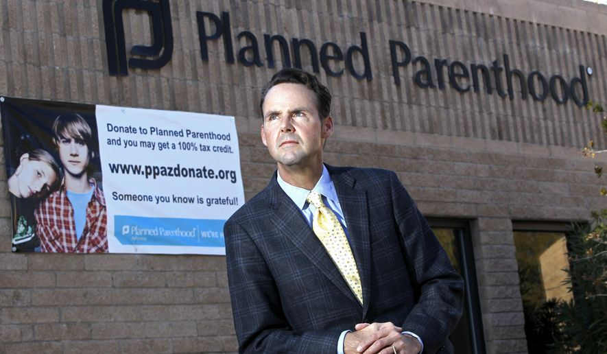 File - This Jan. 23, 2011, file photo, shows Bryan Howard, president of Planned Parenthood Arizona, in front of one of the group's offices in Tucson, Ariz. Planned Parenthood Arizona filed a lawsuit on Thursday, April 11, 2019, that challenges several Arizona laws that it says leave most rural areas in the state without any nearby abortion clinics. (AP Photo/Ross D. Franklin, File)