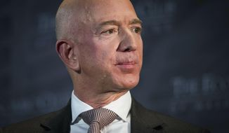 """FILE - In this Sept. 13, 2018, file photo Jeff Bezos, Amazon founder and CEO, speaks at The Economic Club of Washington's Milestone Celebration in Washington. Bezos said in a letter to shareholders Thursday, April 11, 2019, that as Amazon grows, so does the size of its """"failed experiments."""" He said Amazon is willing to continue to take risks and learn from its failures, while simultaneously supporting successful areas of its business like its third-party sellers and retail locations. (AP Photo/Cliff Owen, File)"""