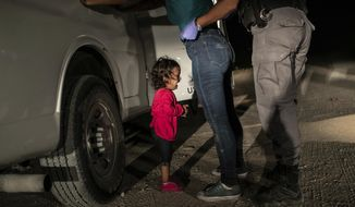 "In this image released by the World Press Photo Foundation Thursday April 11, 2019, by John Moore, Getty Images, which won the World Press Photo of the Year and the first prize in the Spot News, Singles, category, titled ""Crying Girl on the Border"", shows Honduran toddler Yanela Sanchez crying as she and her mother, Sandra Sanchez, are taken into custody by US border officials in McAllen, Texas, USA, on 12 June 2018. (John Moore, Getty Images, World Press Photo Foundation via AP)"