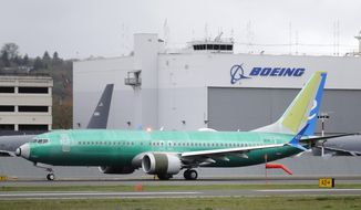 A Boeing 737 MAX 8 airplane being built for Spain-based Air Europa rolls toward takeoff before a test flight, Wednesday, April 10, 2019, at Boeing Field in Seattle. Flight test and other non-passenger-bearing flights of the plane continue in the Seattle area where the plane is manufactured, as a world-wide grounding the the 737 MAX 8 continues, following fatal crashes of MAX 8's operated by Ethiopian Airlines and Lion Air. (AP Photo/Ted S. Warren)