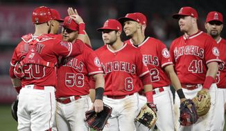 Los Angeles Angels players celebrate the team's 4-2 win over the Milwaukee Brewers in a baseball game Wednesday, April 10, 2019, in Anaheim, Calif. (AP Photo/Jae C. Hong)