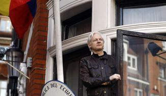 FILE - In this Friday, May 19, 2017 file photo, Julian Assange greets supporters outside the Ecuadorian embassy in London.  London police say they've arrested WikiLeaks founder Julian Assange at the Ecuadorian embassy, it was reported on Thursday, April 11, 2019. (AP Photo/Frank Augstein, File)