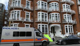 A police van parked outside the Ecuadorian Embassy in London, after WikiLeaks founder Julian Assange was arrested by officers from the Metropolitan Police and taken into custody Thursday April 11, 2019. London police say they've arrested WikiLeaks founder Julian Assange at the Ecuadorian embassy, it was reported on Thursday. (Rebecca Brown/PA via AP)