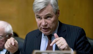 In this Jan. 16, 2019, photo, Sen. Sheldon Whitehouse, D-R.I., questions Andrew Wheeler as he testifies at a Senate Environment and Public Works Committee hearing to be the administrator of the Environmental Protection Agency, on Capitol Hill in Washington. (Associated Press) **FILE**