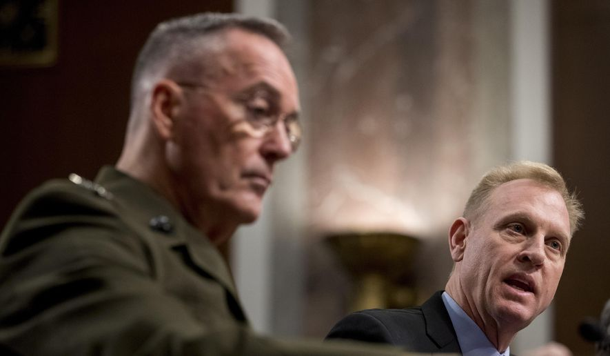Acting Defense Secretary Patrick Shanahan, right, accompanied by Joint Chiefs Chairman Gen. Joseph Dunford, left, speaks during a Senate Armed Services Committee hearing on Capitol Hill in Washington, Thursday, April 11, 2019, on the proposed Space Force. (AP Photo/Andrew Harnik) ** FILE **