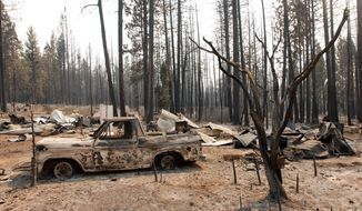 """FILE - In this Wednesday, Aug. 22, 2012, file photo, a damaged truck sits among other remains at a rural house site outside Manton, Calif., where a huge wildfire burned through on Saturday, forcing residents to evacuate. A McClatchy analysis reveals more than 350,000 Californians live in towns and cities that exist almost entirely within """"very high fire hazard severity zones."""" (AP Photo/Jeff Barnard, File)"""