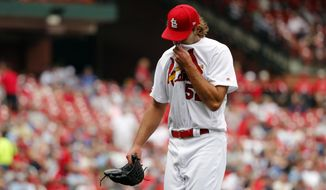 St. Louis Cardinals starting pitcher Michael Wacha walks off the field after being removed during the fourth inning of a baseball game against the Los Angeles Dodgers Thursday, April 11, 2019, in St. Louis. (AP Photo/Jeff Roberson)