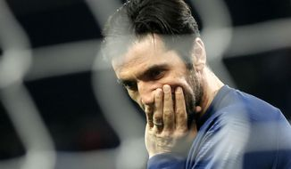 FILE - In this March 17, 2019 file photo, PSG's goalkeeper Gianluigi Buffon appears to be in a pensive mood prior to the French League One soccer match between Paris-Saint-Germain and Olympique Marseille at the Parc des Princes stadium in Paris. When Paris Saint-Germain owners signed Buffon last summer in the hope of finally winning the Champions League, they expected him to deliver at big games. Not only Buffon did not make the saves they wanted in Europe's top competition, but the former Juventus 'keeper has also been mediocre in the French league. (AP Photo/Christophe Ena, File)