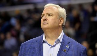 FILE - In this Jan. 25, 2019, file photo, Memphis Grizzlies general manager Chris Wallace stands on the court before an NBA basketball game between the Grizzlies and the Sacramento Kings in Memphis, Tenn. The Grizzlies have fired coach J.B. Bickerstaff as part of a front-office shake-up in which general manager Chris Wallace was demoted to a scout Thursday, April 11, 2019. (AP Photo/Brandon Dill, File)