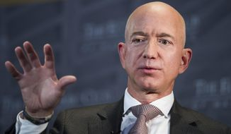 FILE - In this Sept. 13, 2018, file photo, Jeff Bezos, Amazon founder and CEO, speaks at The Economic Club in Washington. Federal prosecutors in New York are planning to meet with Bezos about his allegations that the National Enquirer tried to blackmail him with help from Saudi Arabia. (AP Photo/Cliff Owen, File)