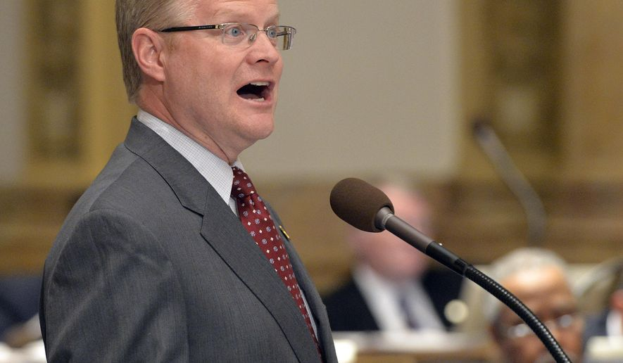"""FILE - In this March, 24, 2015, file photo, Kentucky Senate Majority Leader Damon Thayer addresses the Kentucky Senate in support of the heroin treatment bill at the Kentucky State Capitol in Frankfort, Ky. Thayer says Gov. Matt Bevin's veto of a pension bill was a """"big mistake,"""" and says there's no guarantee lawmakers will resolve the issue in a special session. (AP Photo/Timothy D. Easley, File)"""