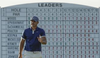 Brooks Koepka walks on the 17th hole during the first round for the Masters golf tournament Thursday, April 11, 2019, in Augusta, Ga. (AP Photo/Charlie Riedel)