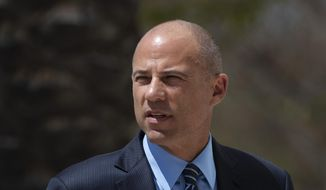 In this April 1, 2019, file photo, attorney Michael Avenatti arrives at federal court in Santa Ana, Calif. An indictment filed against Avenatti, Wednesday, April 10, alleges he stole millions of dollars from clients, didn't pay his taxes, committed bank fraud and lied in bankruptcy proceedings. (AP Photo/Jae C. Hong)