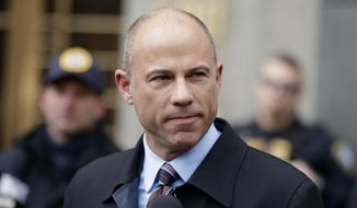 In this Dec. 12, 2018, file photo, attorney Michael Avenatti, speaks outside courthouse in New York. An indictment filed against Avenatti, Wednesday, April 10, alleges he stole millions of dollars from clients, didn't pay his taxes, committed bank fraud and lied in bankruptcy proceedings. (AP Photo/Julio Cortez, File)