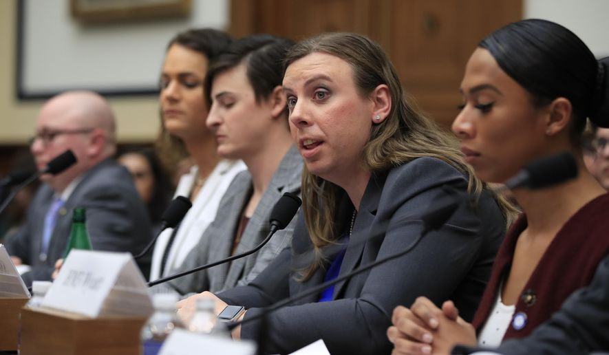 """In this Feb. 27, 2019 file photo, Army Staff Sgt. Patricia King, second from right, together with other transgender military members, from left, Navy Lt. Cmdr. Blake Dremann, Army Capt. Alivia Stehlik, Army Capt. Jennifer Peace and Navy Petty Officer Third Class Akira Wyatt, testify about their military service before a House Armed Services Subcommittee on Military Personnel hearing on Capitol Hill in Washington. A new Trump administration regulation set to go into effect Friday, April 12,  directs military secretaries to kick out transgender service members who refuse to serve in their birth sex and """"given an opportunity to correct those deficiencies."""" (AP Photo/Manuel Balce Ceneta, File) **FILE**"""