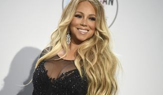FILE - In this Oct. 9, 2018, file photo Mariah Carey poses in the press room at the American Music Awards at the Microsoft Theater in Los Angeles. No artist has more No. 1 hits on the Billboard Hot 100 chart than Mariah Carey, and she will receive the Icon Award at the 2019 Billboard Music Awards. NBC and Dick Clark Productions announced Thursday, April 11, 2019, that the Grammy-winning superstar will also perform at the May 1 event in Las Vegas. (Photo by Jordan Strauss/Invision/AP, File)