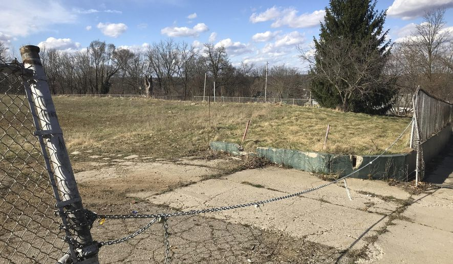 This Tuesday, April 9, 2019 shows  the former Wilson Academy site along Spring and Orient streets in Battle Creek, Mich. A project to grow trees on the former Wilson Academy site  has come to an end.Greenprint Partners, formerly known as Fresh Coast Capital, has returned the vacant two acres it leased from the city and Battle Creek Public Schools.(Kalea Hall/Battle Creek Enquirer via AP)