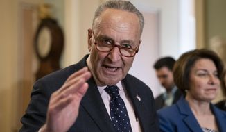 Senate Minority Leader Chuck Schumer, D-N.Y., joined at right by Sen. Amy Klobuchar, D-Minn., speaks to reporters at the Capitol in Washington, Tuesday, April 9, 2019. (AP Photo/J. Scott Applewhite)