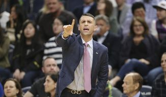 Minnesota Timberwolves coach Ryan Saunders calls out to his team during the second half of an NBA basketball game against the Golden State Warriors, Friday, March 29, 2019, in Minneapolis. Minnesota won 131-130 in overtime. (AP Photo/Stacy Bengs)