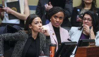 Rep. Alexandria Ocasio-Cortez, D-N.Y., left, joined by Rep. Ayanna Pressley, D-Mass., and Rep. Rashida Tlaib, D-Mich., listens during a House Oversight and Reform Committee meeting, on Capitol Hill in Washington, Tuesday, Feb. 26, 2019. House Democrats are rounding the first 100 days of their new majority taking stock of their accomplishments, noting the stumbles and marking their place as a frontline of resistance to President Donald Trump. (AP Photo/J. Scott Applewhite) ** FILE **