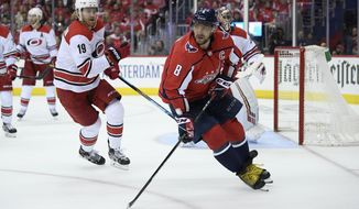 Washington Capitals left wing Alex Ovechkin (8), of Russia, skates on the ice in front of Carolina Hurricanes defenseman Dougie Hamilton (19) during the second period of Game 1 of an NHL hockey first-round playoff series, Thursday, April 11, 2019, in Washington. (AP Photo/Nick Wass) ** FILE **