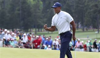 Tiger Woods fist-pumps as he birdies the ninth hole during the second round of the Masters golf tournament at Augusta National Golf Club, Friday, April 12, 2019, in Augusta, Ga. (Curtis Compton/Atlanta Journal-Constitution via AP)