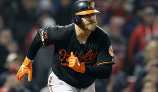 Baltimore Orioles' Chris Davis (19) starts to run on his line out during the ninth inning of a baseball game against the Boston Red Sox in Boston, Friday, April, 12, 2019. (AP Photo/Michael Dwyer) ** FILE **