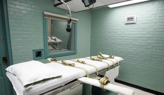 """This May 27, 2008, file photo, shows the gurney in the death chamber in Huntsville, Texas. A supplier of Texas' execution drugs can remain secret under a court ruling that cited a risk of """"physical harm"""" to the compounding pharmacy if the information became public. The Texas Supreme Court's decision Friday, April 12, 2019, ends a long-running legal battle that began in 2014 over the drugs used in the nation's busiest execution chamber. (AP Photo/Pat Sullivan, File) **FILE**"""