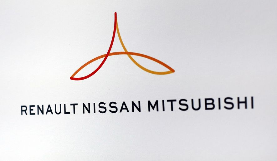 FILE - This Friday Sept. 15, 2017 file photo shows the logo of the Renault-Nissan-Mitsubishi alliance during a press conference in Paris. The new board of the Renault-Nissan-Mitsubishi alliance is holding its first meeting to plot out the group's future without jailed former boss Carlos Ghosn. (AP Photo/Thibault Camus, File)
