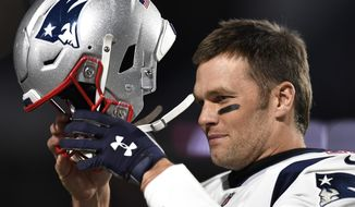 FILE - In this Oct. 29, 2018, file photo, New England Patriots quarterback Tom Brady puts on his helmet for warmups prior to an NFL football game against the Buffalo Bills, in Orchard Park, N.Y. Improvements that an NFL and NFLPA study found in helmets didn't help Tom Brady. The six-time Super Bowl champion quarterback will have to discard his longtime brand as one of 11 helmets banned by the league and players' union for 2019. Brady was one of 32 players wearing helmets last season under a grace period that is now eliminated.(AP Photo/Adrian Kraus, File)