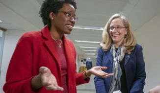 Rep. Lauren Underwood, D-Ill., left, speaks with Rep. Abigail Spanberger, D-Va., on Capitol Hill in Washington, Wednesday, April 3, 2019. House Democrats are rounding the first 100 days of their new majority taking stock of their accomplishments, noting the stumbles and marking their place as a frontline of resistance to President Donald Trump.(AP Photo/J. Scott Applewhite)