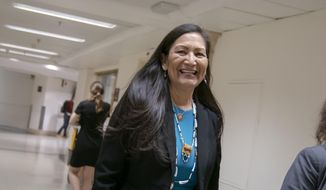 Rep. Deb Haaland, D-N.M., the first Native American woman elected to Congress, is seen on Capitol Hill in Washington, Wednesday, April 3, 2019. House Democrats are rounding the first 100 days of their new majority taking stock of their accomplishments, noting the stumbles and marking their place as a frontline of resistance to President Donald Trump. (AP Photo/J. Scott Applewhite) **FILE**