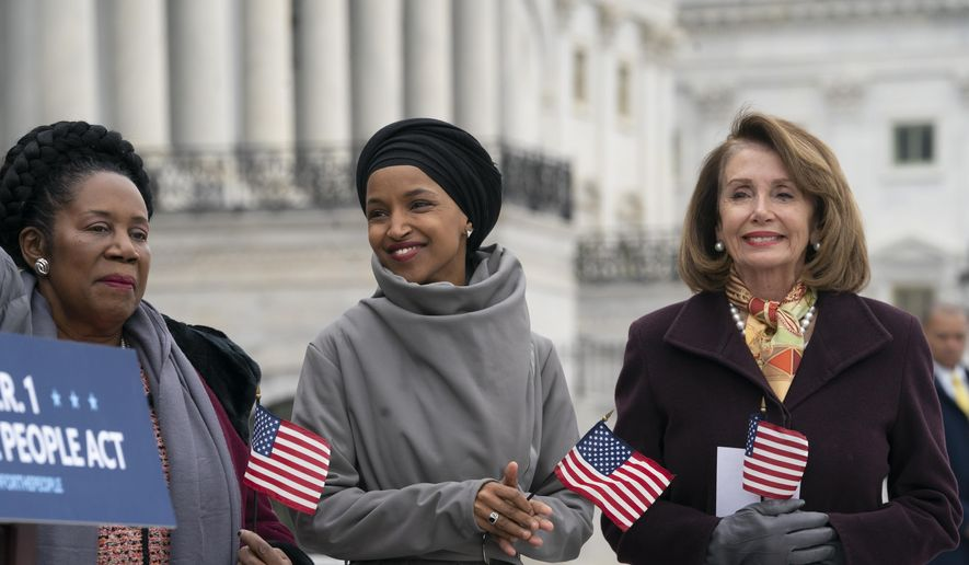 "Freshman Rep. Ilhan Omar, D-Minn., center, smiles as she stands between Rep. Sheila Jackson Lee, D-Texas, left, and Speaker of the House Nancy Pelosi, D-Calif., as Democrats rally outside the Capitol ahead of passage of H.R. 1, ""The For the People Act,"" a bill which aims to expand voting rights and strengthen ethics rules, in Washington, Friday, March 8, 2019. (AP Photo/J. Scott Applewhite) ** FILE **"