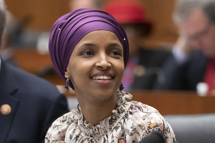 Rep. Ilhan Omar, D-Minn., sits with fellow Democrats on the House Education and Labor Committee during a bill markup, on Capitol Hill in Washington, Wednesday, March 6, 2019.  House Democrats are rounding the first 100 days of their new majority taking stock of their accomplishments, noting the stumbles and marking their place as a frontline of resistance to President Donald Trump. (AP Photo/J. Scott Applewhite)