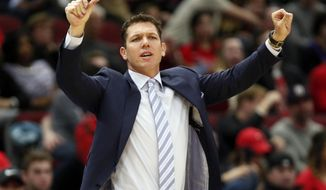 FILE - In this March 12, 2019, file photo, Los Angeles Lakers coach Luke Walton gestures to players during the second half of an NBA basketball game against the Chicago Bulls in Chicago. The Lakers say they have mutually agreed to part ways with Walton after three losing seasons. Lakers general manager Rob Pelinka announced Walton's departure Friday, April 12, 2019. (AP Photo/Nuccio DiNuzzo,File)
