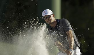 Zach Johnson hits on the 18th hole during the first round for the Masters golf tournament Thursday, April 11, 2019, in Augusta, Ga. (AP Photo/Marcio Jose Sanchez)